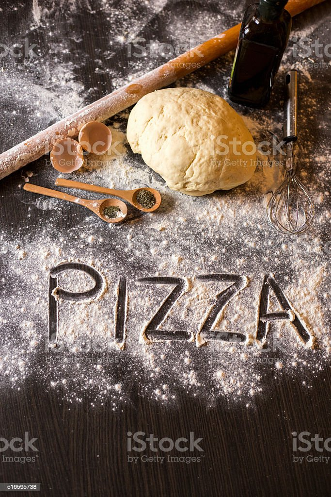Dough and ingredients for pizza stock photo