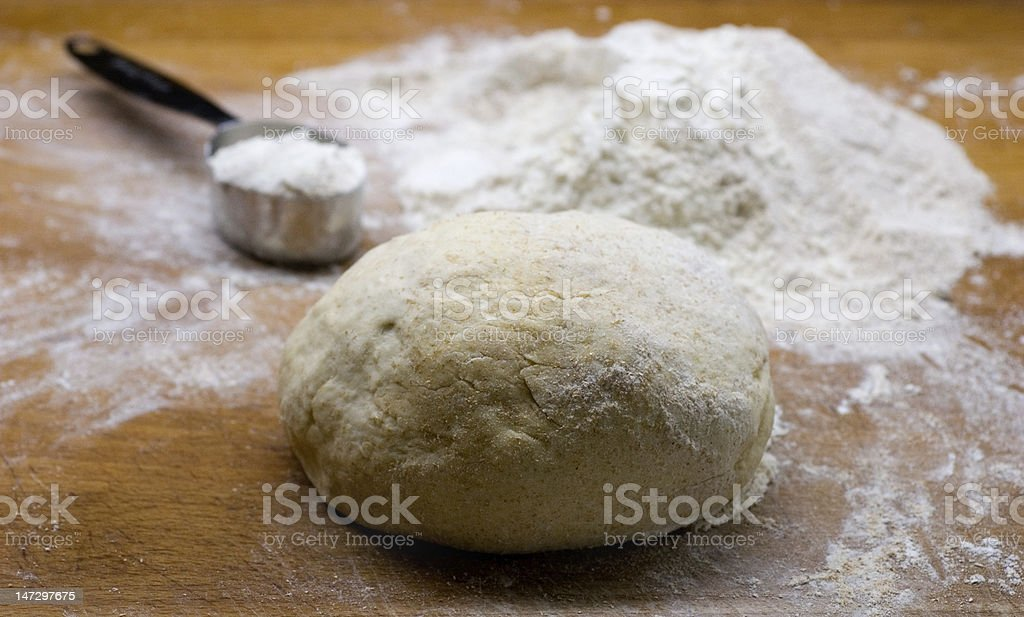 Dough and measuring cup royalty-free stock photo