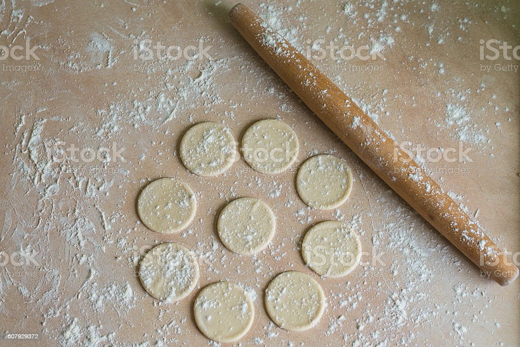 Dough circles and rolling pin stock photo