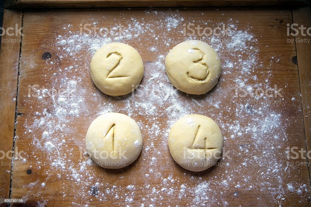 Dough into four equal portions and numbered stock photo