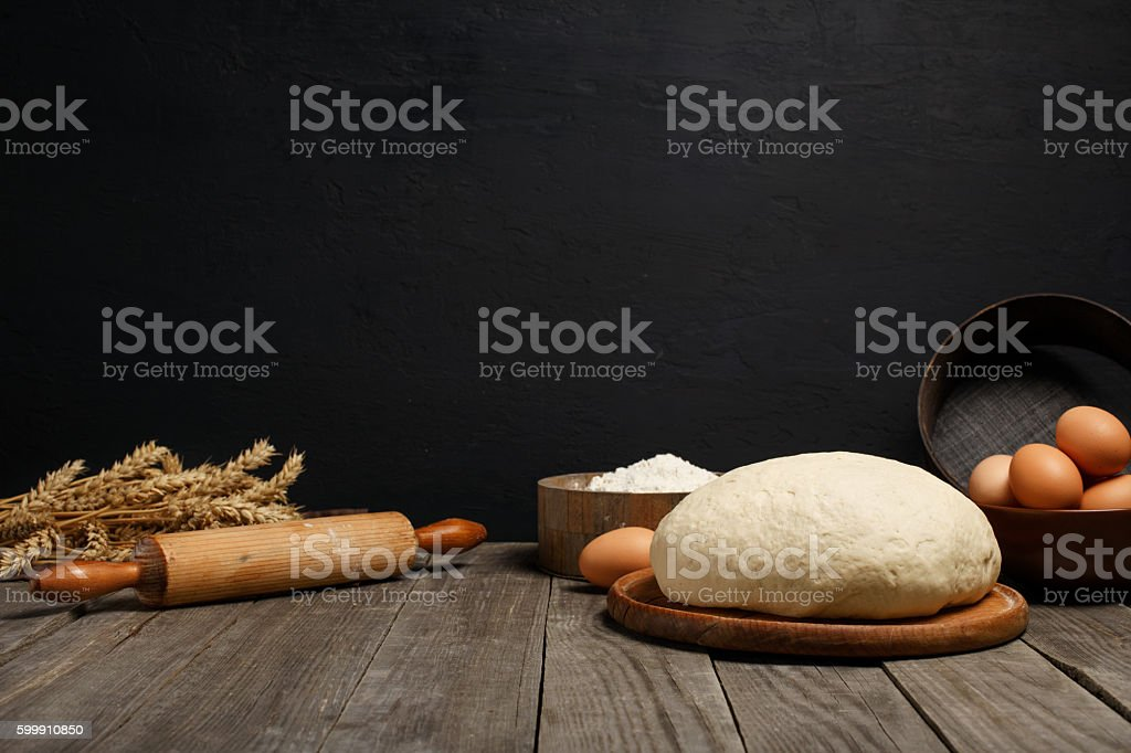 Dough on table with space for an object in bakery stock photo