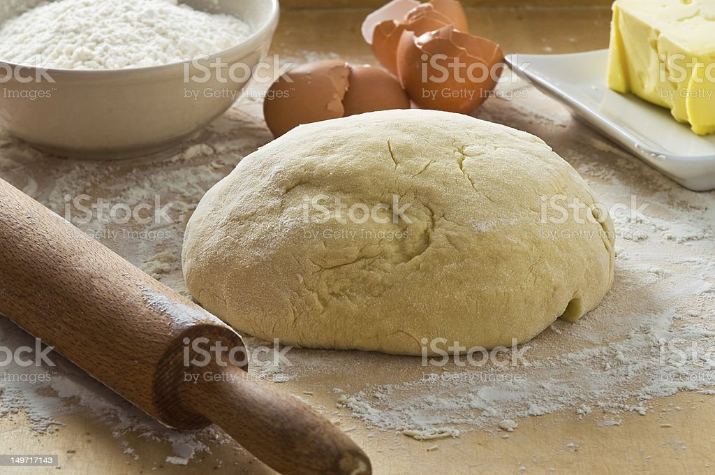 Dough on wooden board. stock photo