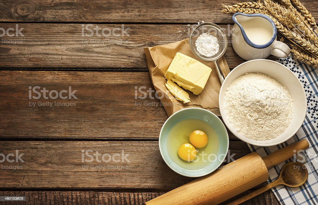 Dough recipe ingredients on vintage rural wood kitchen table stock photo
