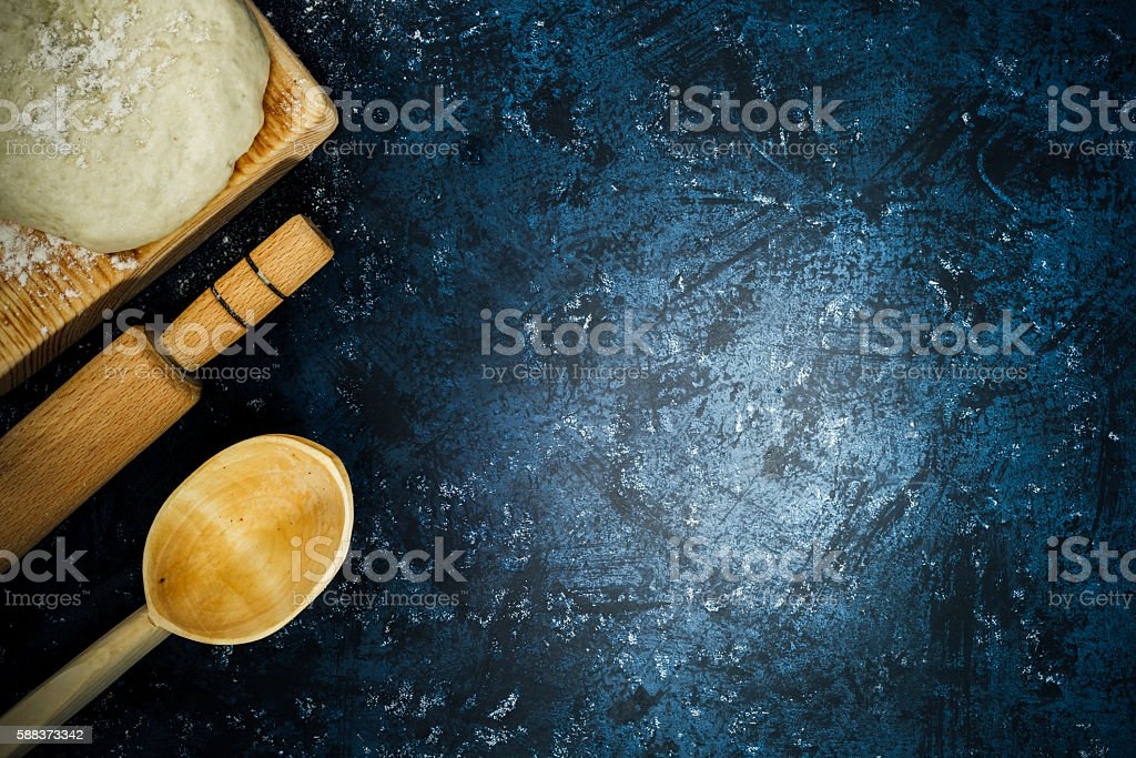 Dough, rolling pin and ladle stock photo