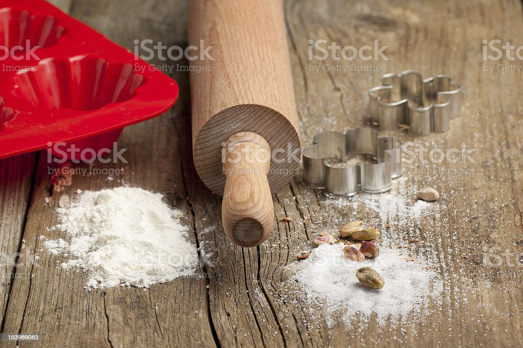 Dough, sugar and rolling-pin royalty-free stock photo