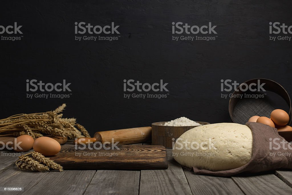 Dough with ingredients for cooking dough on wooden table stock photo