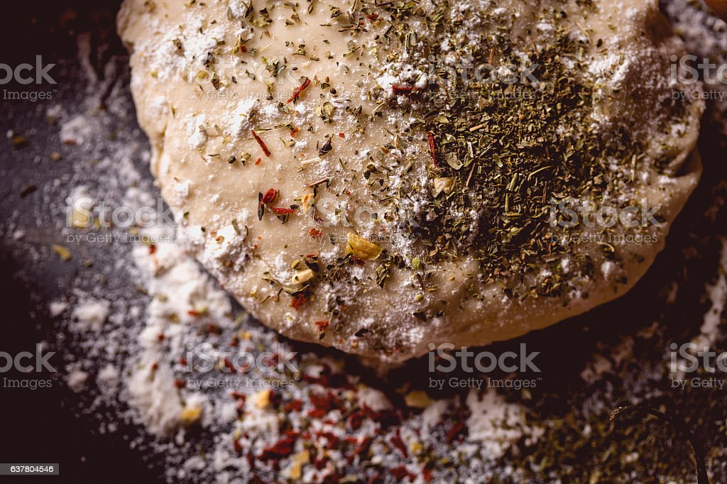 Dough with spices is being prepared to bake stock photo
