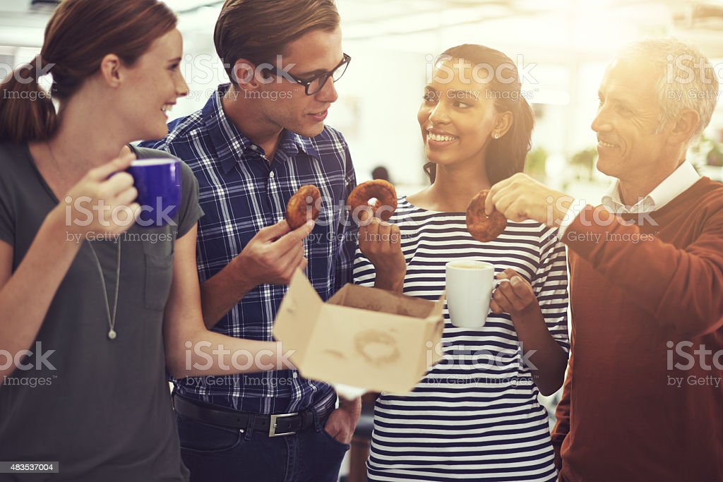 Doughnuts and coffee: the perfect coffee break combo stock photo