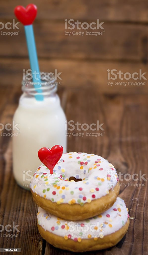 Doughnuts with heart and milk royalty-free stock photo
