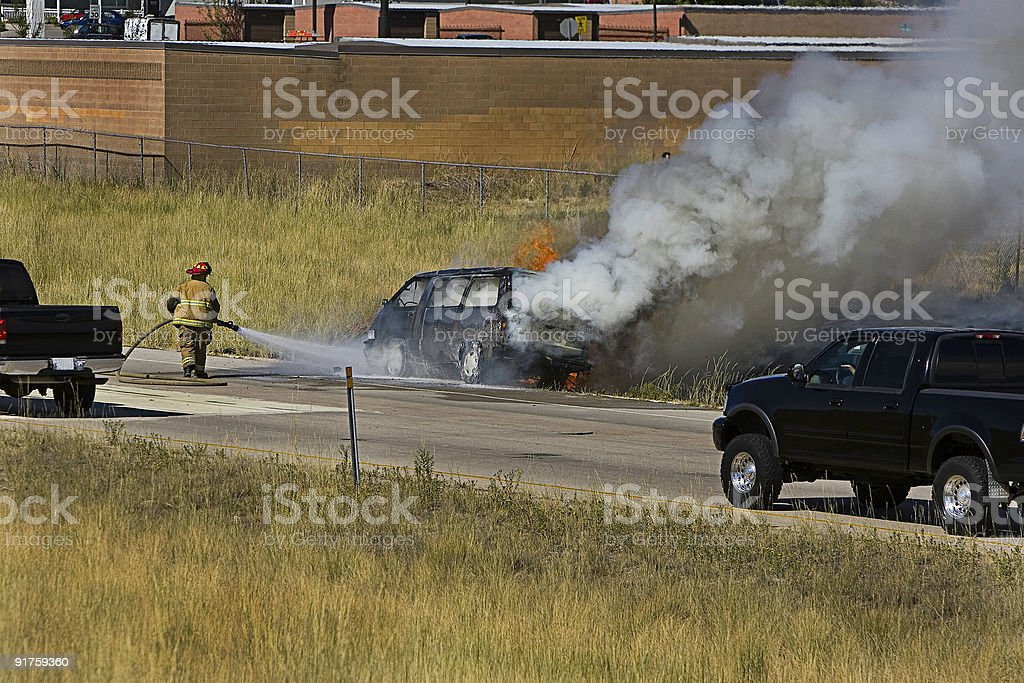 Dousing a Car Fire royalty-free stock photo