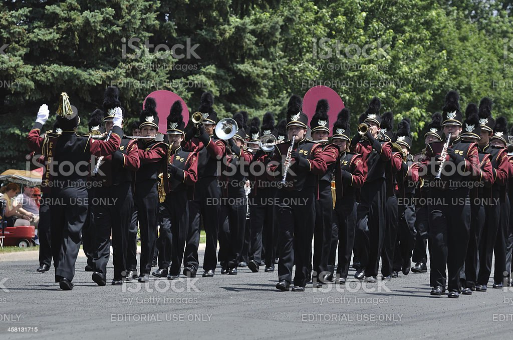 Dover-Eyota High School Marching Band Performing in a Parade royalty-free stock photo