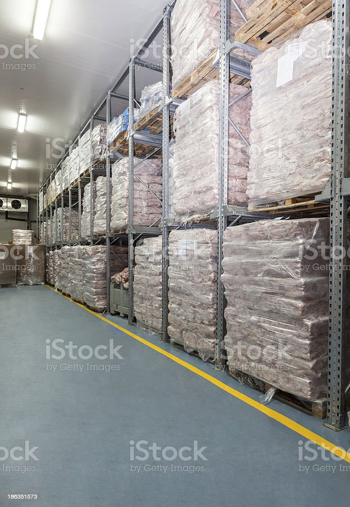 Down aisle view of refrigerator storage in a warehouse stock photo