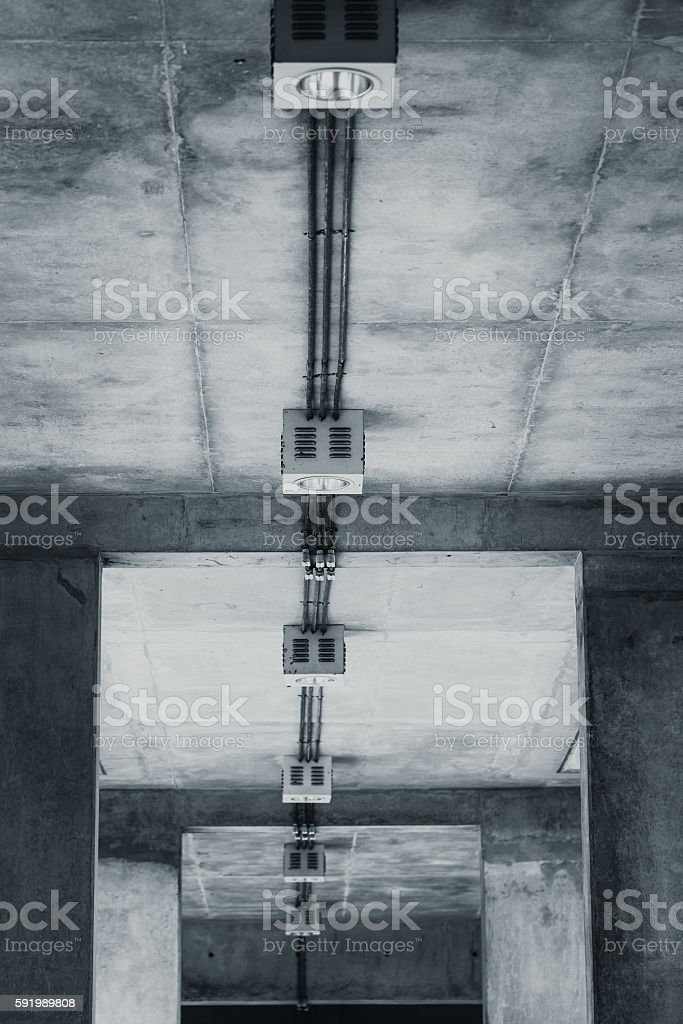 Down light on exposed concrete wall. stock photo