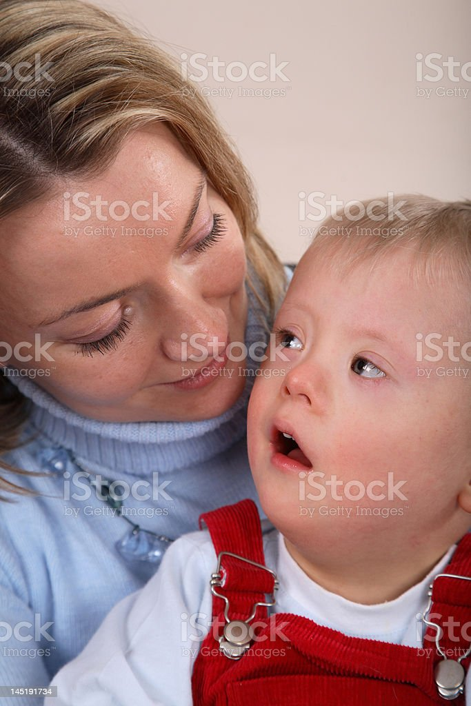 Down Syndrome boy and mother royalty-free stock photo