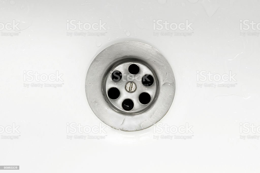 Down the drain stock photo