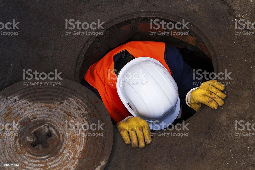 Down The Manhole stock photo