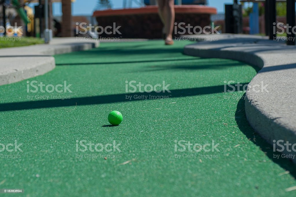Down the miniature putting green stock photo
