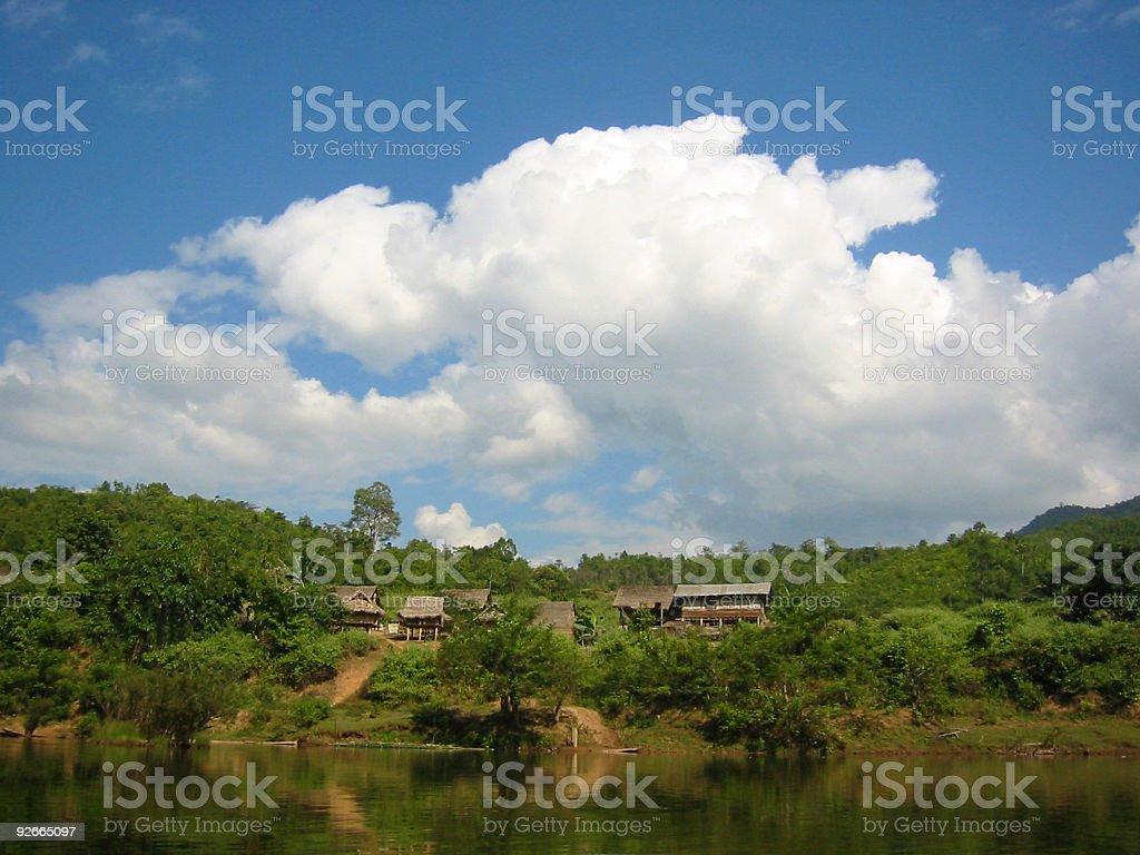 down the river rural laos village royalty-free stock photo