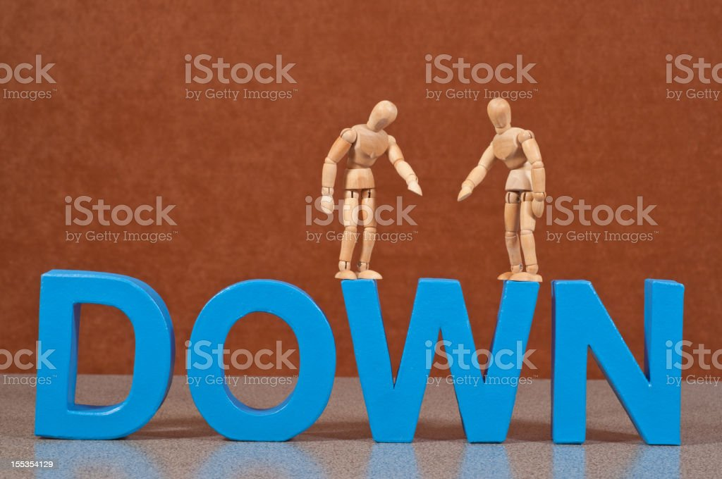 Down  - Wooden Mannequin demonstrating this word stock photo