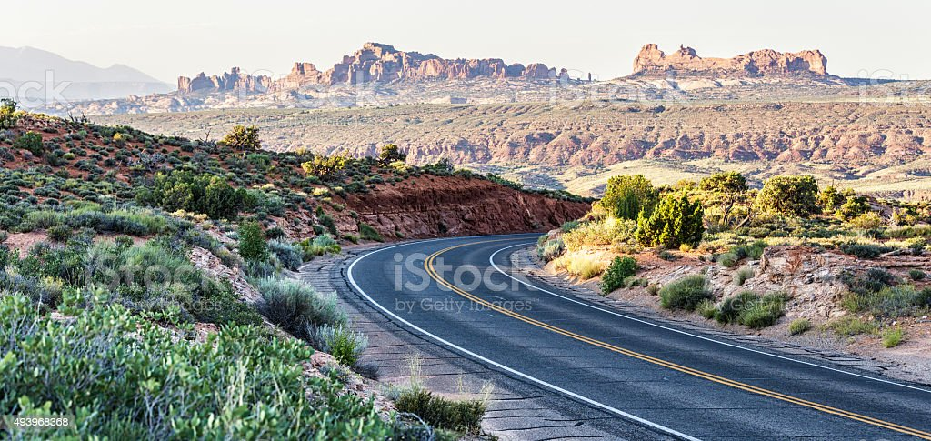 Downhill Curve Desert Highway - Arches National Park Utah USA stock photo