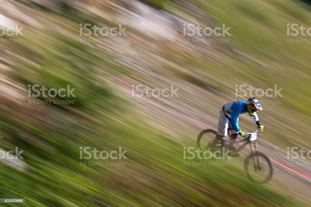 Downhill Mountain Bike Racer stock photo