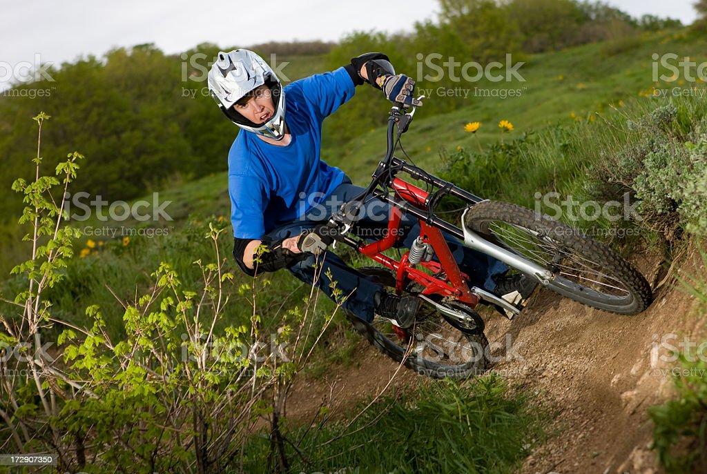 Downhill Mountain Biker in Tight Corner royalty-free stock photo