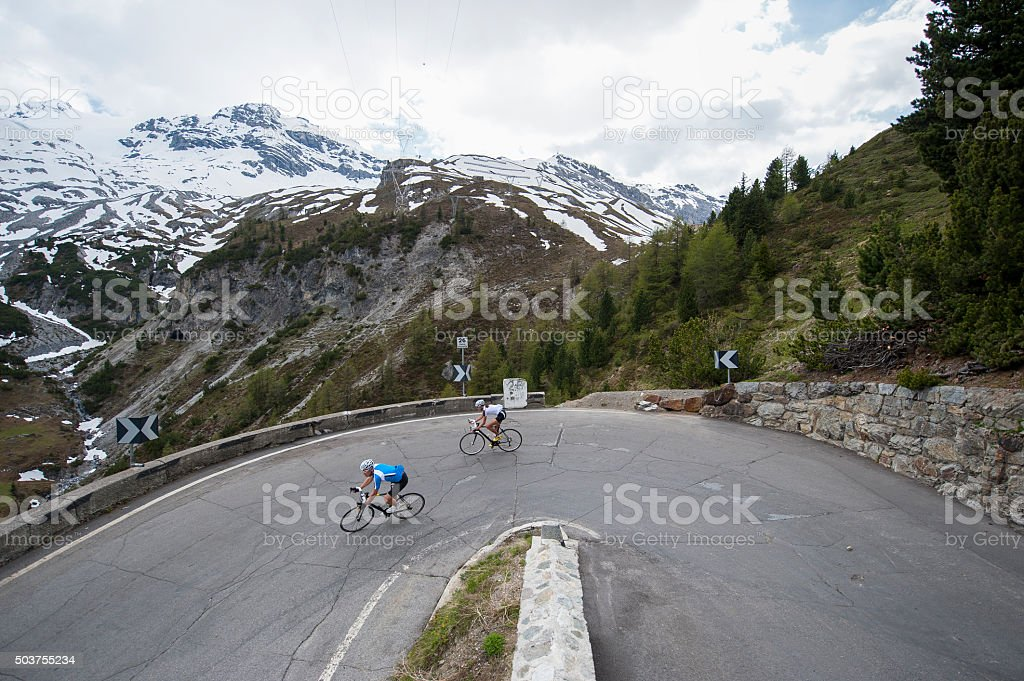 downhill roadcycling pursuit - bike downhill stock photo