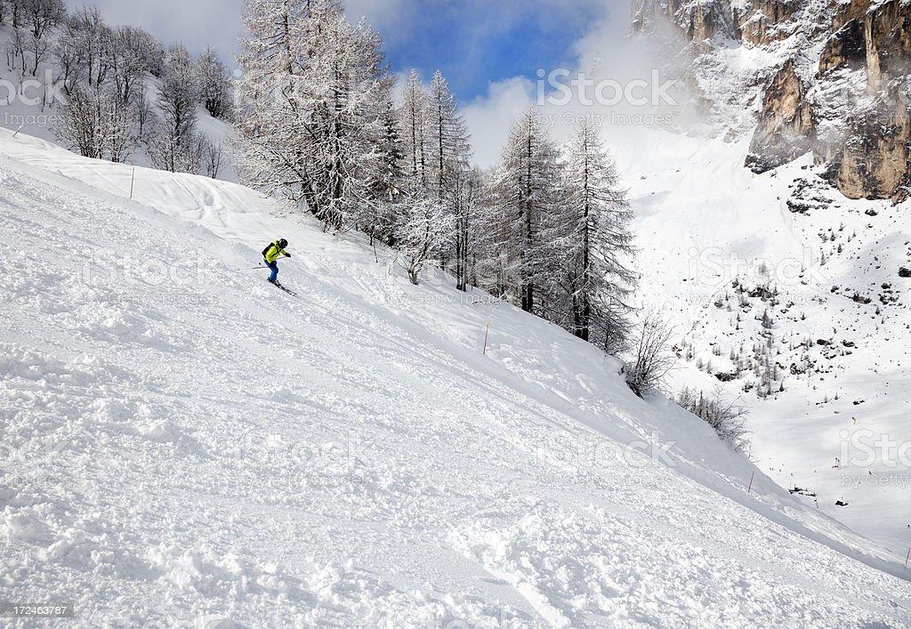 Downhill Skier in Dolomites, Italy stock photo