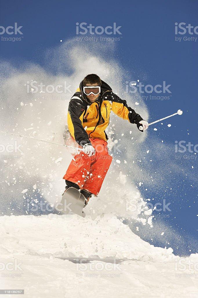 Downhill Skier Making A Jump stock photo