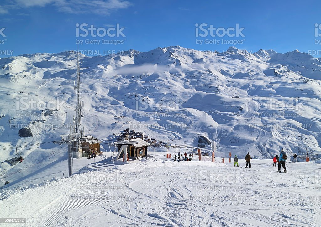 Downhill skiing and snowboarding in French winter resort stock photo