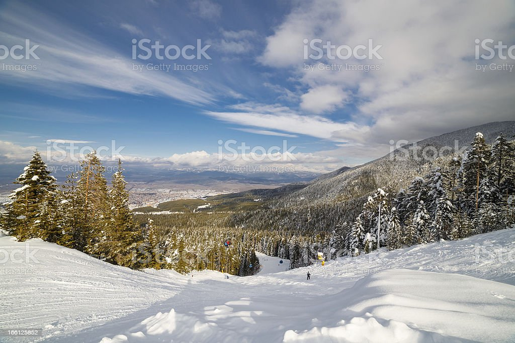 Downhill skiing in sunny day royalty-free stock photo