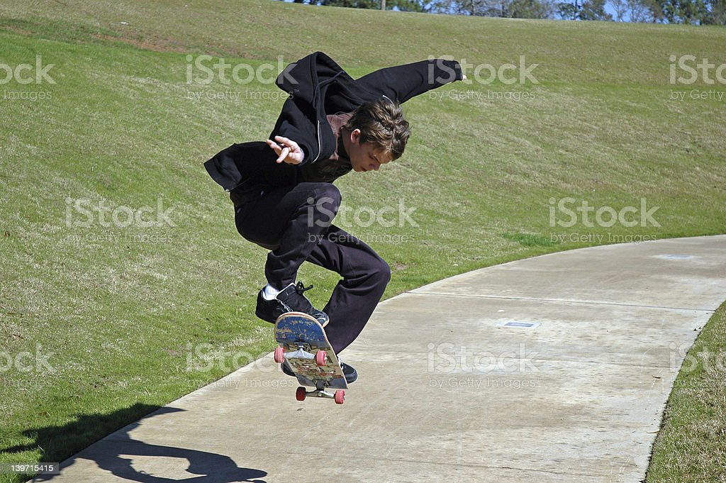 Downhill Teen Skateboarder stock photo