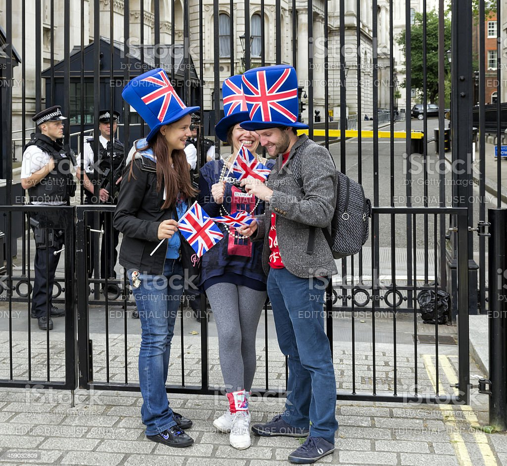 Downing Street gates with tourists and police stock photo