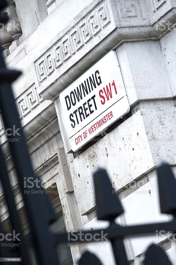 Downing Street sign on building facade stock photo