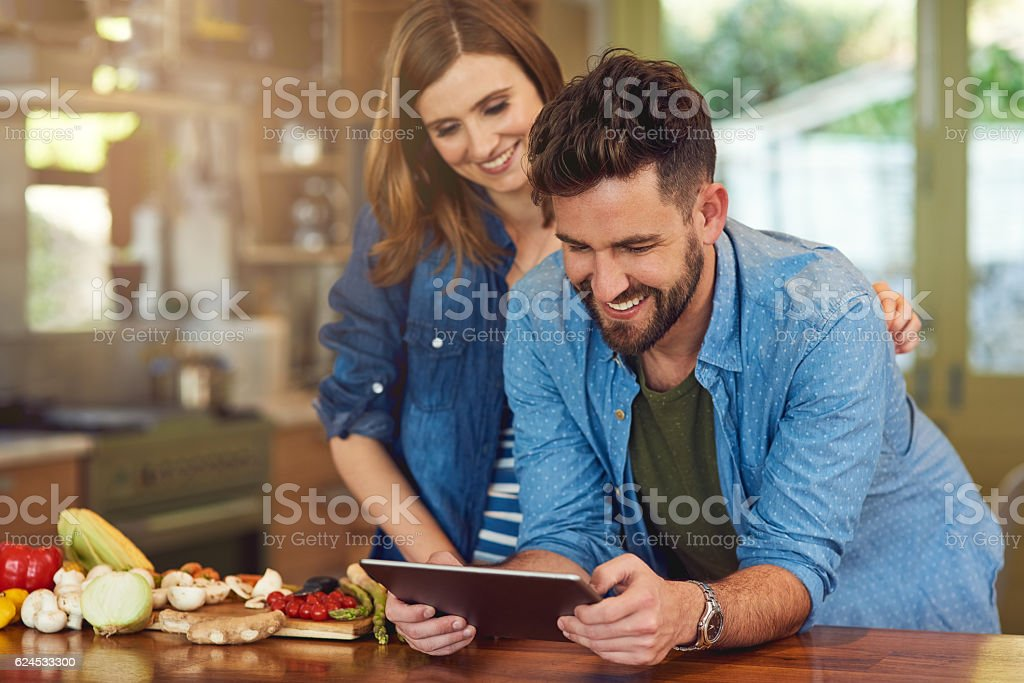 Downloading a healthy meal plan to try as a couple stock photo