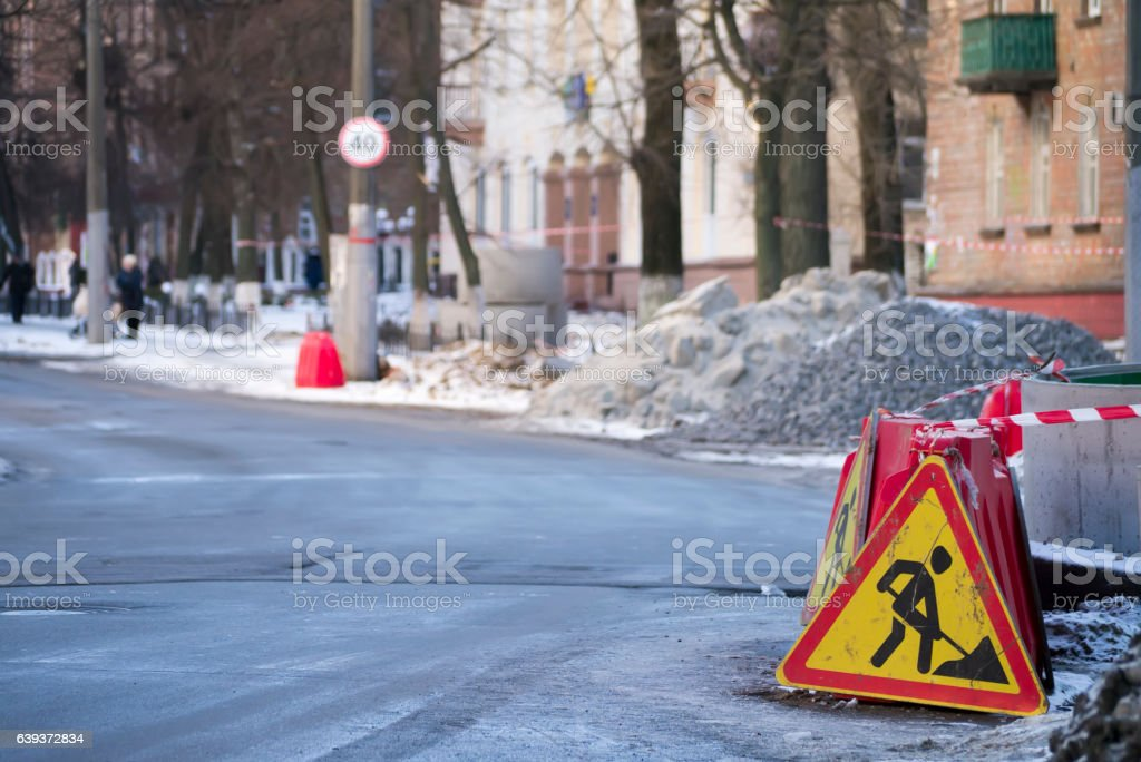 Downtime during communication line reconstraction, road sign stock photo