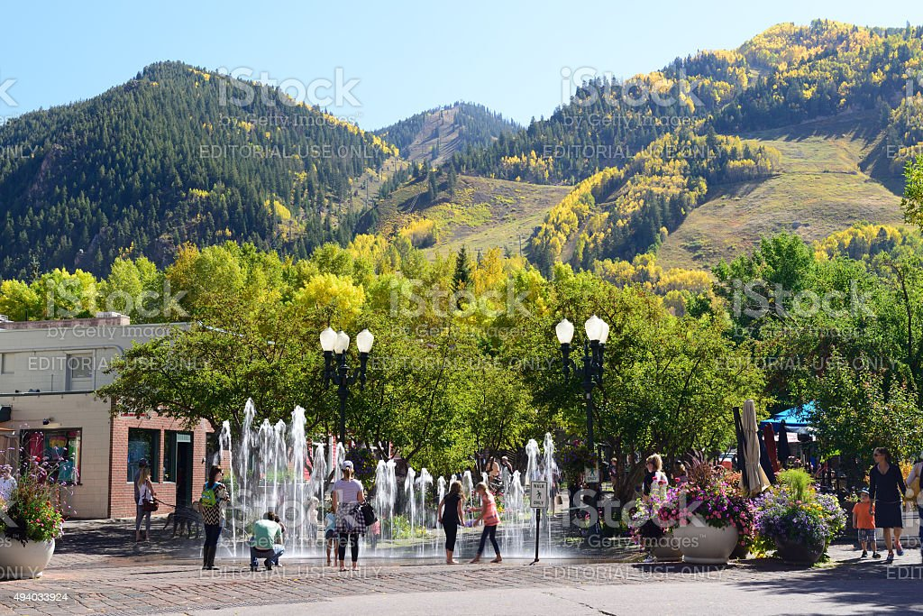 Downtown Aspen with Kids Playing Fountain stock photo