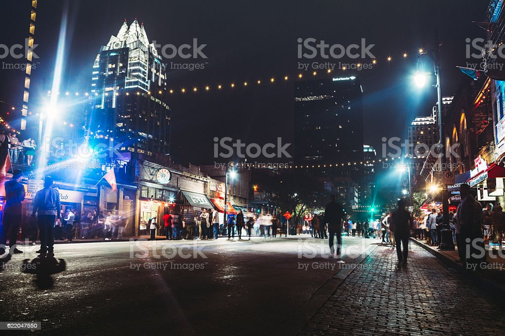 Downtown Austin at Night on Sixth Ave stock photo