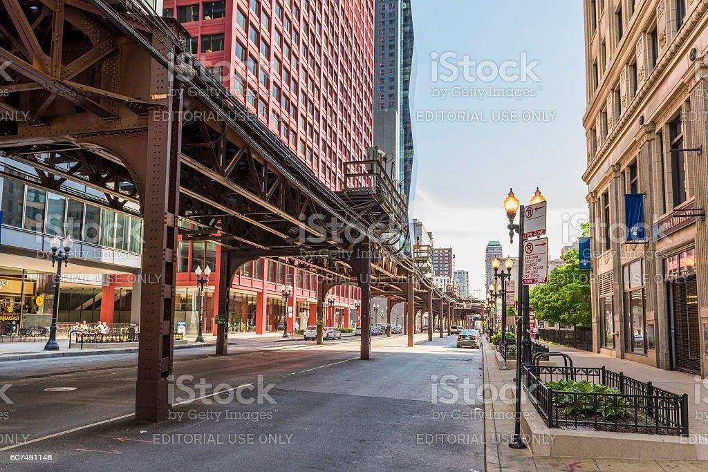 Downtown Chicago street with CTA train metro rail line stock photo