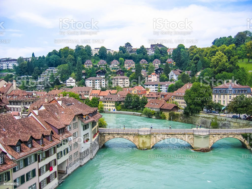 Downtown city aerial cityscape or skyline with light green river during summer with old buildings stock photo