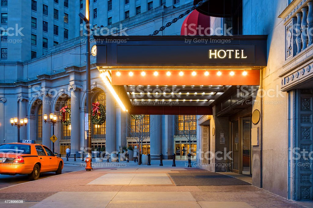 Downtown Cleveland Hotel Entrance and Waiting Taxi Cab stock photo