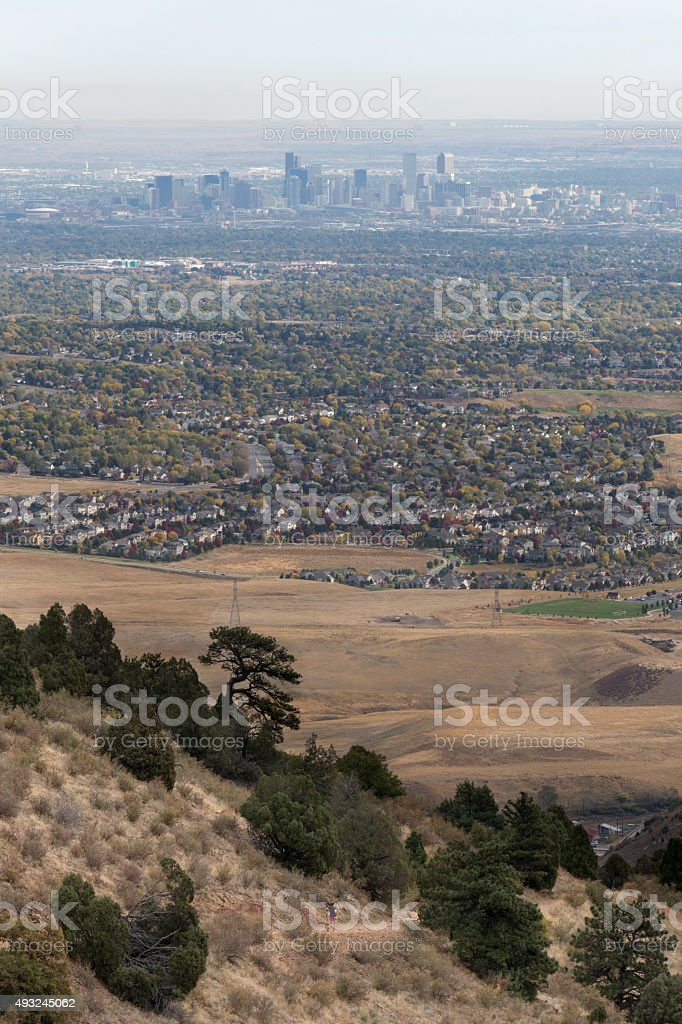 Downtown Denver and woman trail running Morrison Colorado Rocky Mountains stock photo