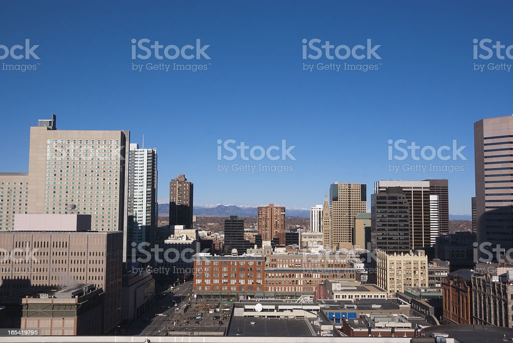 Downtown Denver skyline with mountains stock photo