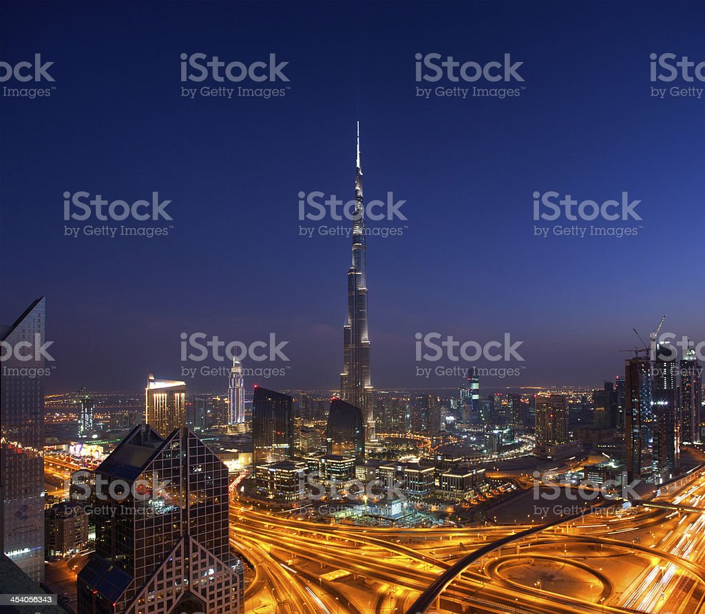 Downtown Dubai at night showing the Burj Khalifa and Fountain stock photo