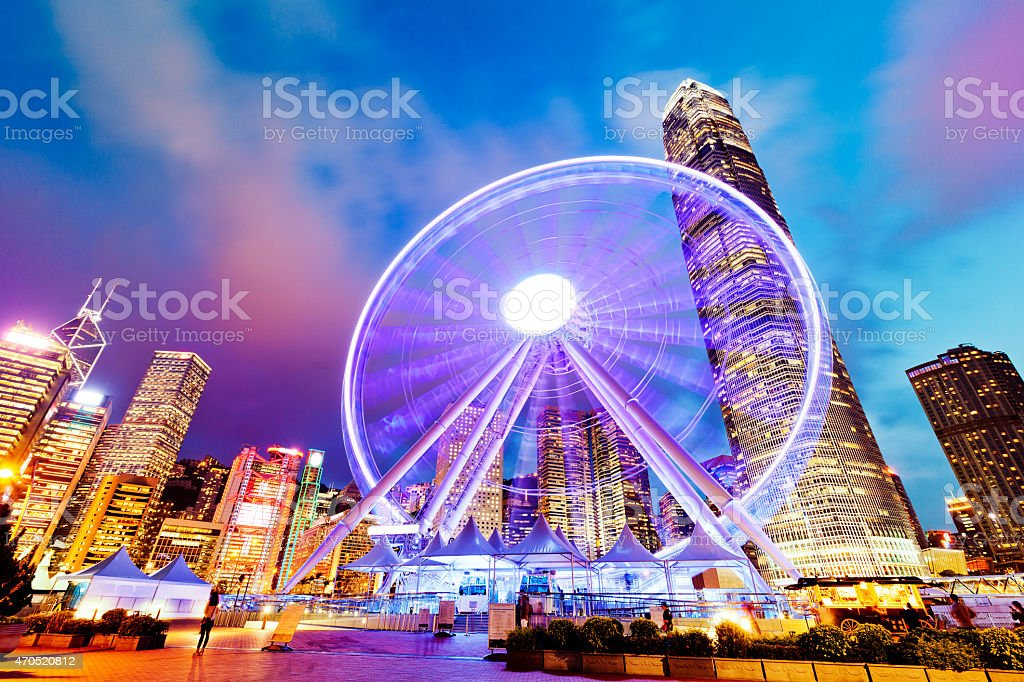 Downtown Hong Kong at night with lit observation wheel stock photo