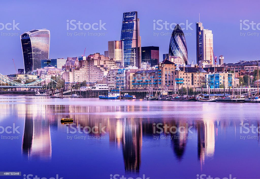 Downtown London City Skyline Reflection in River Thames at Night stock photo