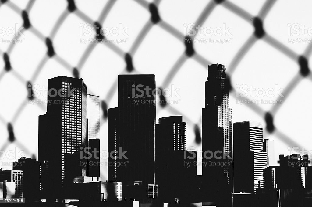 Downtown Los Angeles seen through fence. stock photo