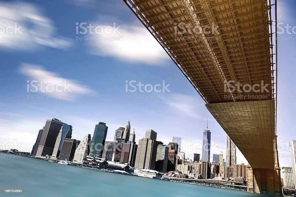 Downtown Manhattan seen under the Brooklyn Bridge royalty-free stock photo