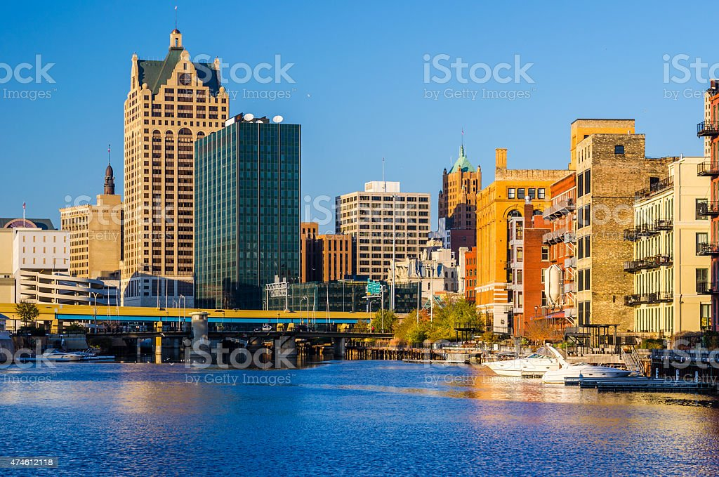 Downtown Milwuakee buildings, boats, and river during the late afternoon stock photo