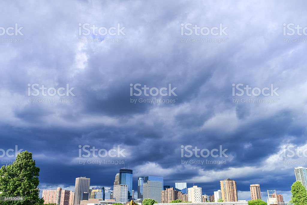 Downtown Minneapolis Skyline and Dramatic Cloudy Skys stock photo
